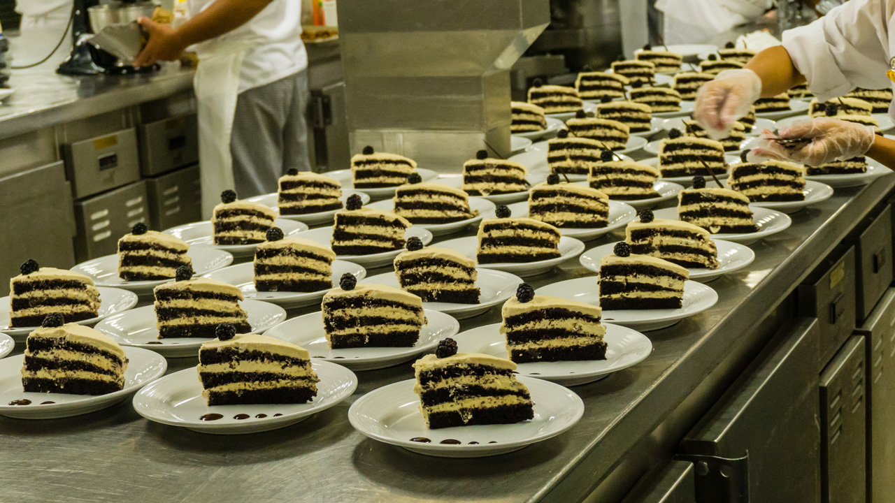 Assembly line of Chocolate cake on a Cruise ship